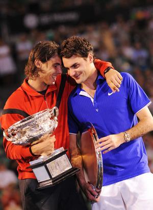 Rafael  Nadal consoles Roger Federer.